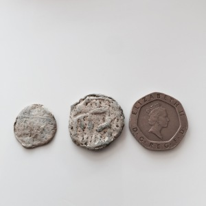 Two 'floral' tokens. The far left was found today.